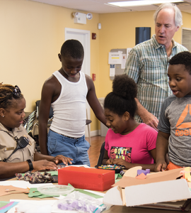 Cpl. Lewis and Black Cherry Puppet Theater's Michael Lamason help some PAL kids create a storyboard for a puppet show.