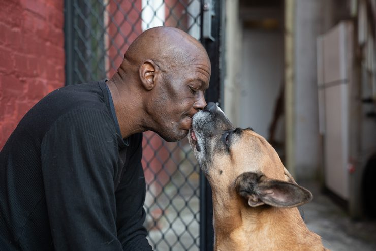 Maurice Joyner and his dog, King, who he has trained in German. That way, King won't listen to strangers' commands. He once lost a dog to someone who called his dog over, and then stole him.